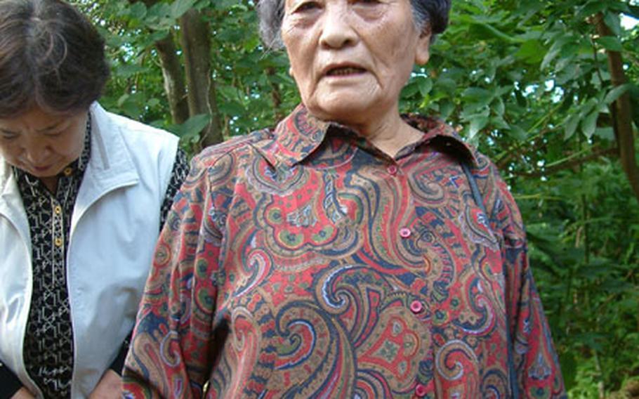 Toyo Fukuji, 80, grew up in the area of the Iibaru Bijuru, a Shinto prayer site rededicated Thursday on Kadena Air Base.