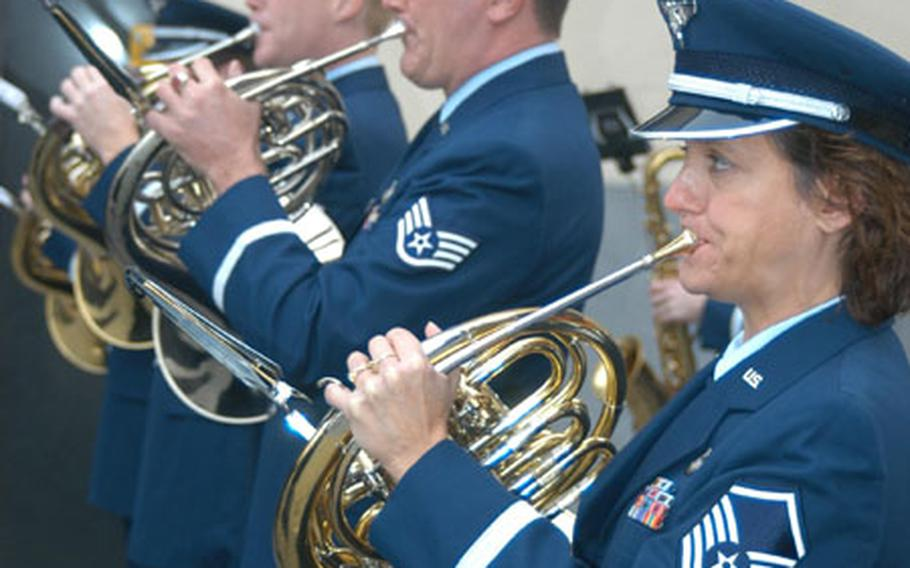 Master Sgt. Ellen Polachek and the rest of the horn section of the U.S. Air Forces in Europe Band warm up during a recent gig in Oudenaarde, Belgium.