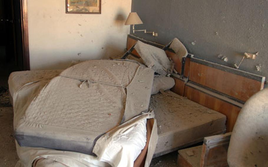 A room on the 15th floor of the Palestine Hotel in Baghdad, Iraq, shows the damage after rocket attacks Friday morning.