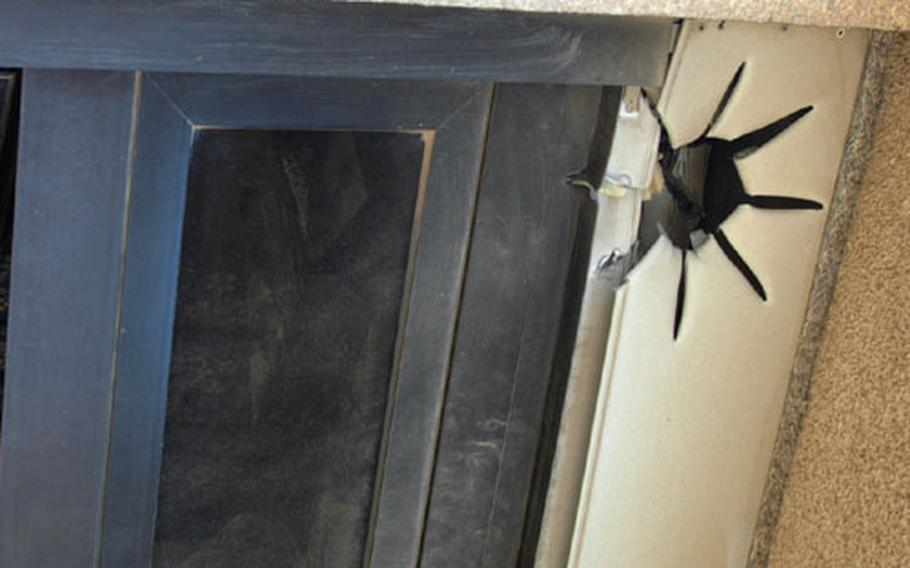 This star-shaped puncture is what's left after the passage of a rocket's stabilization fins through a balcony-door frame on the eighth-floor of the Palestine Hotel in Baghdad, Iraq, after rocket attacks Friday morning.