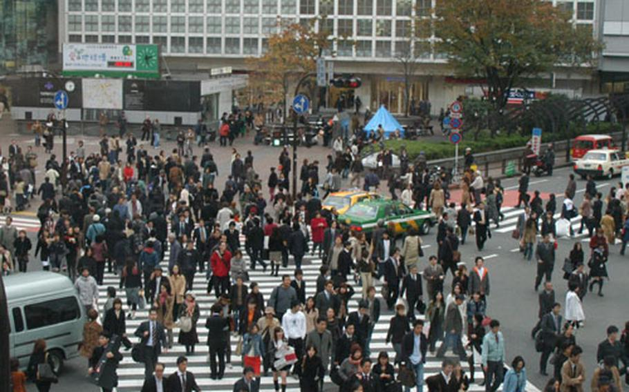 Crowds cross the street in Shibuya, a popular area of Tokyo, on Tuesday.