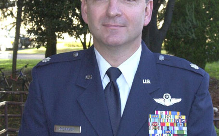 Lt. Col. Richard J. Dieringer of Yokota Air Base proudly wears the Bronze Star Medal and Air Medal he was awarded Friday for his service while deployed to Uzbekistan for Operation Enduring Freedom.