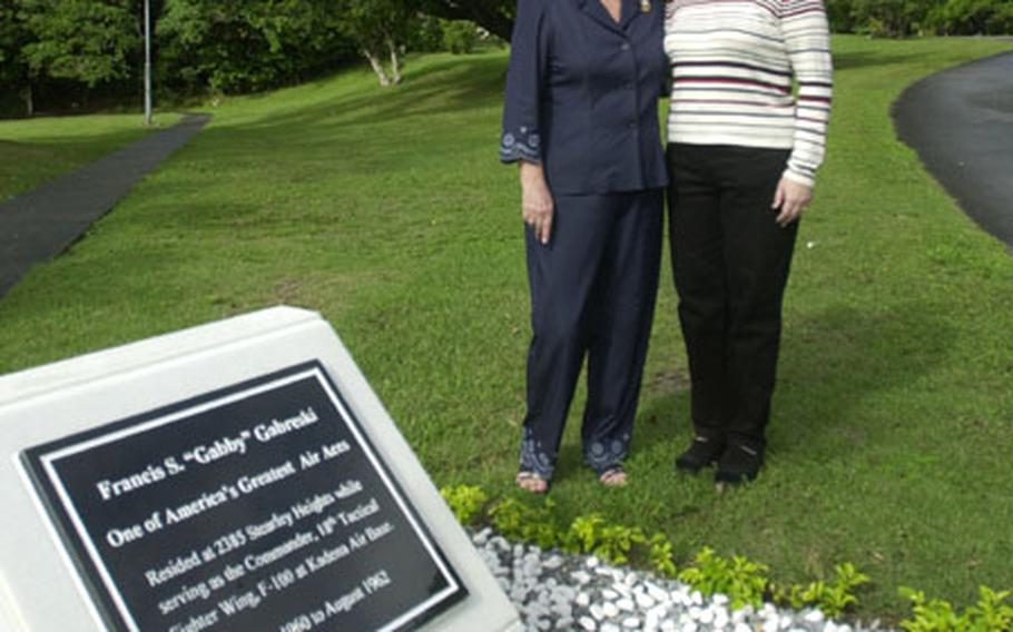 """Gayle Stevenson Goodman, left, and Lori Dallas stand by the monument honoring Col. Francis S. """"Gabby"""" Gabreski on Kadena Air Base. Gabreski was the eighth Jet Ace in history."""