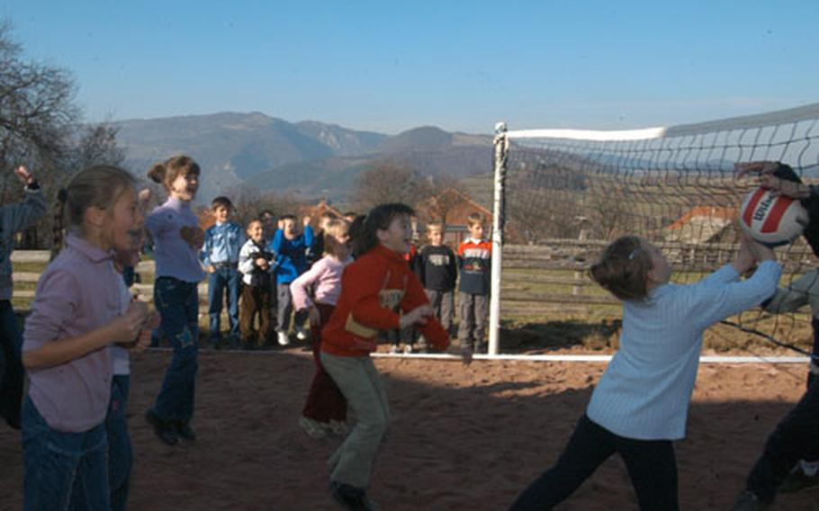 Children of Budozelje enjoy their new volleyball court. The construction material for the playground built by American and Turkish soldiers was paid for by the Organization for Security and Cooperation in Europe.