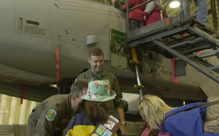 Girl Scouts and Brownies from Osan Air Base get a look in and under an A-10 attack jet Sunday.