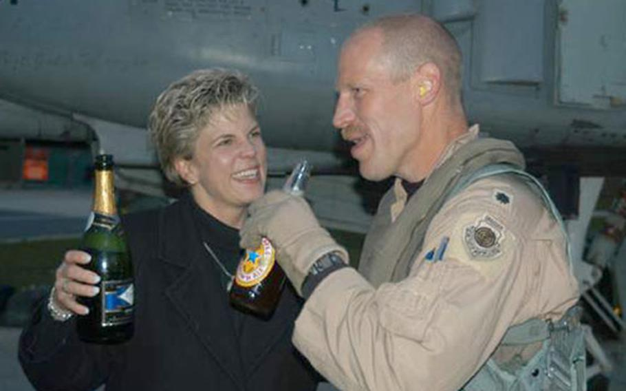 Lt. Col. Patrick Malackowski and his wife, Carol, share a drink after he returned Monday from Bagram, Afghanistan. Malackowski, commander of the 81st Fighter Squadron, returned with seven others from the squadron - the last of the squadron to finish the six-month deployment.