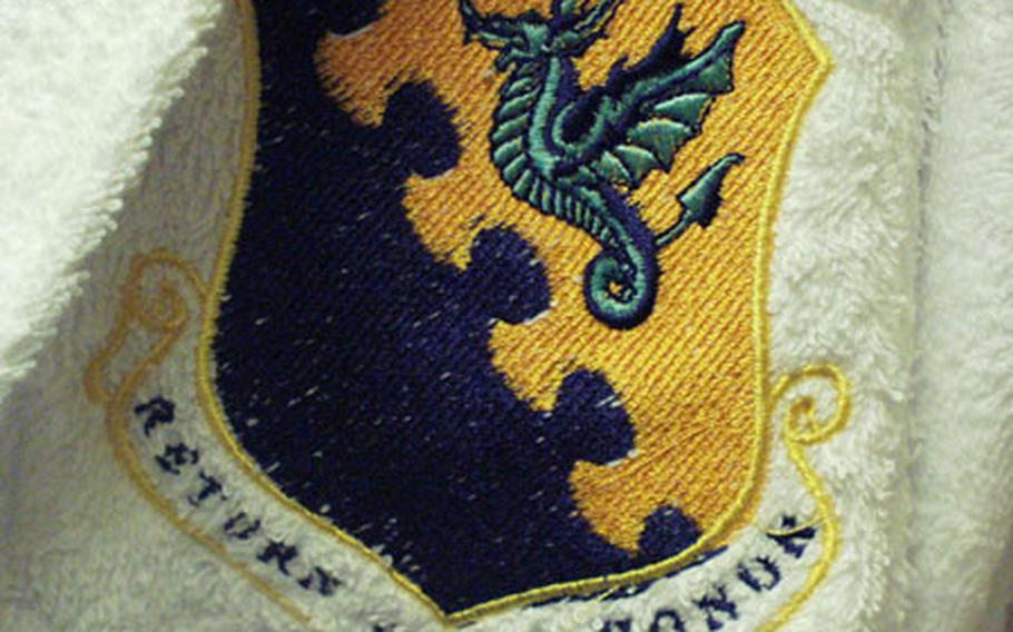 """There are a few perks in the """"distinguished visitors"""" suites at the Mountain View Lodge, such as these robes — with the emblem of the 31st Fighter Wing sewn on — that come with the rooms. There are six such suites in the facility. They even have dishwashing machines."""