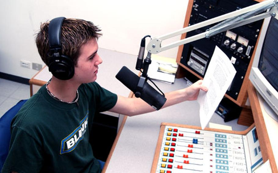 Michael Lahrman, a junior at Naples High School in Italy, practices a script he prepared for an upcoming spot on American Forces Network radio. Lahrman hopes the experience he gets at AFN will help him get a job in sports broadcasting.