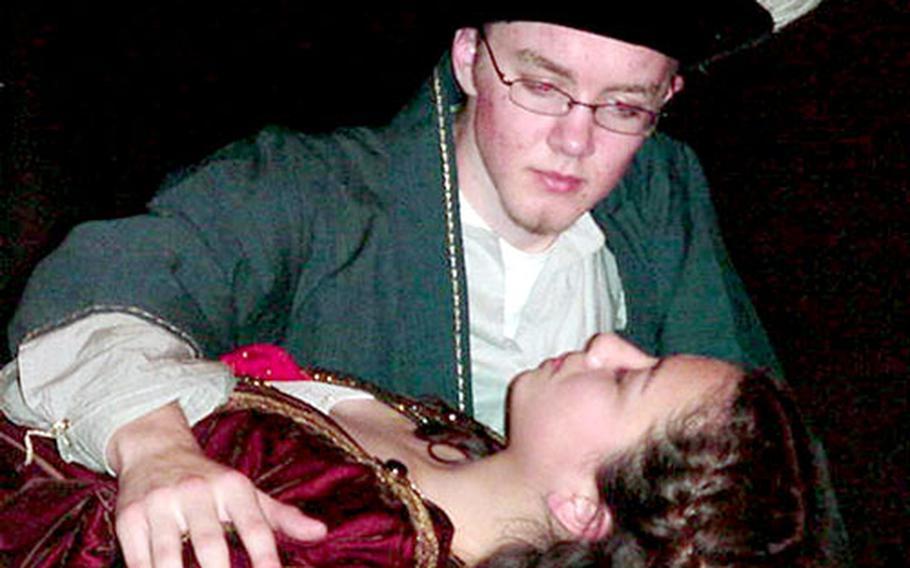 Romeo (Matt Plastow), believing Juliet (Anna Kiner) dead, seeks one final kiss.