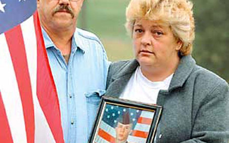 Guy and Mary Hayslett hold a photo of their son, Sgt. Timothy Hayslett, who was killed Saturday in Iraq. A funeral was held Monday in Pennsylvania for Hayslett, who was a member of Headquarters and Headquarters Company, 1st Battalion, 37th Armored Regiment, 1st Brigade of the 1st Armored Division.