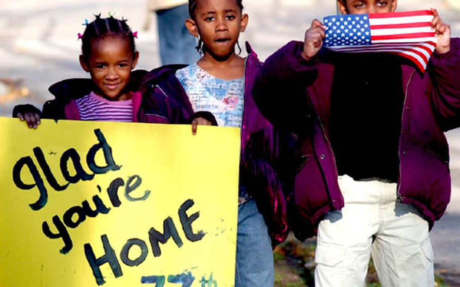 Sisters Katara, Kalia and Ka-imani Burks welcome members of the 77th Maintenance Company home from Iraq at Babenhausen, Germany on Wednesday. The kids were there to greet a family friend.
