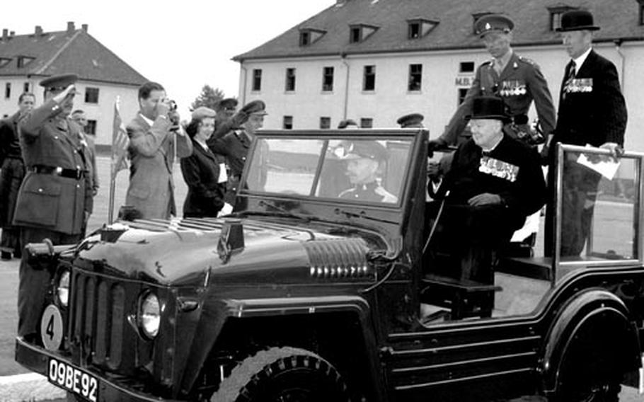 Former British Prime Minister Sir Winston Churchill reviews his old regiment, the 4th Queen's Own Hussars, at Hohne, West Germany, in May, 1956.