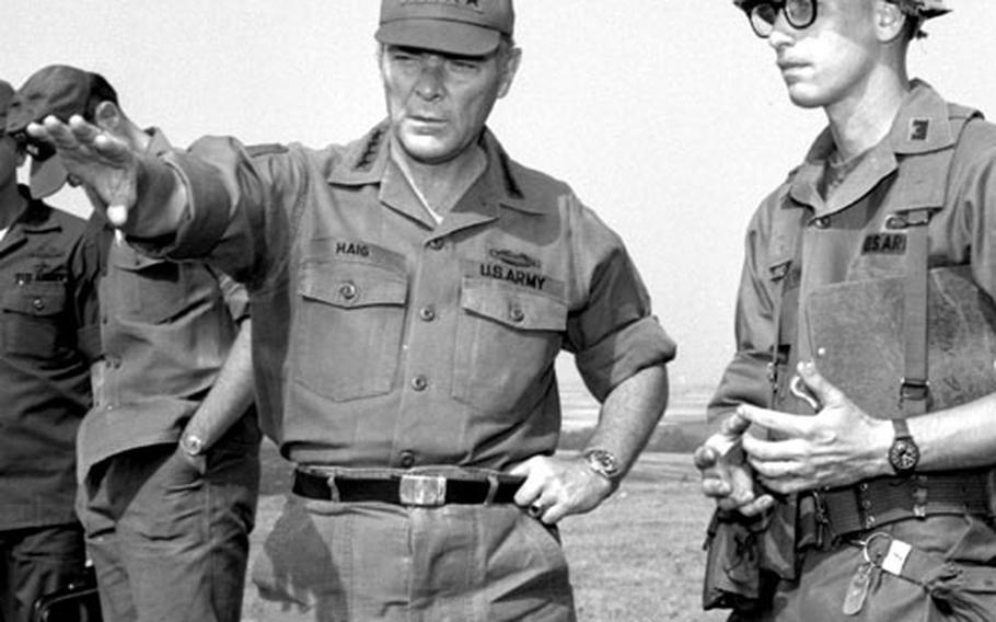 Gen. Alexander M. Haig, Supreme Allied Commander, Europe, visits with U.S. troops at training Area M, near Schweinfurt, Germany, in August, 1976.