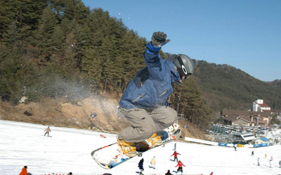 A snowboarder at the terrain park at Yongpyong resort.