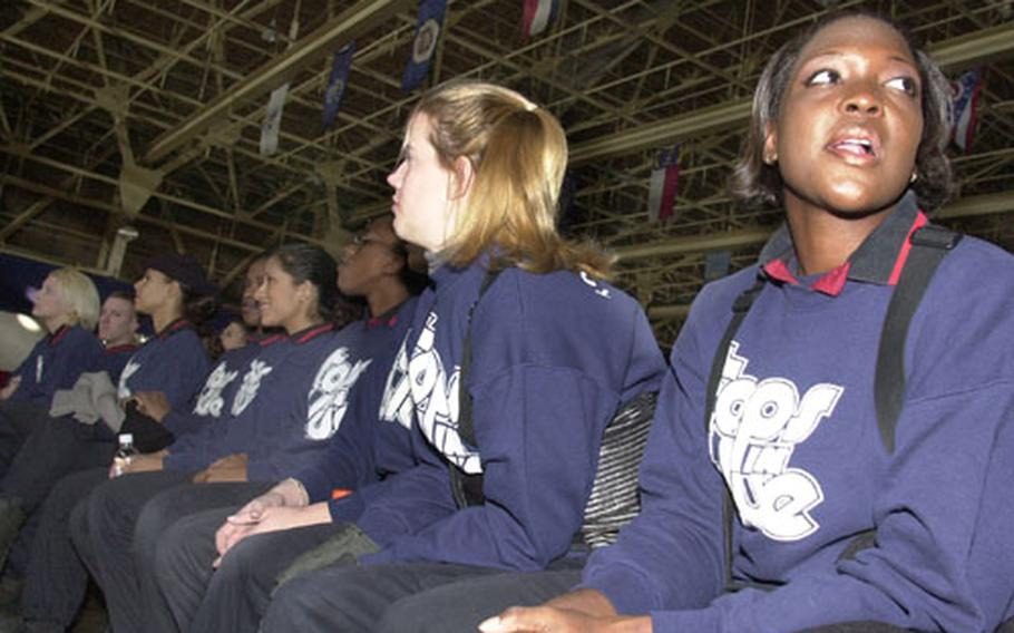 Senior Airman Takeesha Washington-Nash, a Tops In Blue vocalist and weapons loader with the 18th Aircraft Maintenance Squadron, Kadena Air Base, sits through a Tops In Blue briefing Wednesday morning prior to the New Year's Eve show at Misawa Air Base, Japan.