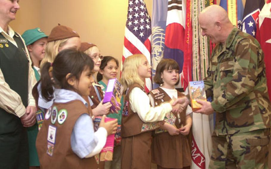 U.S. Forces Korea commander Gen. Leon LaPorte buys the first boxes of Girl Scout cookies sold this year in South Korea. Girl Scouts throughout the peninsula will officially kick off the sales Friday afternoon.