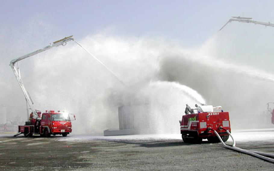 The Tokyo Metropolitan Fire Department demonstrates extinguishing chemical fires using foam.