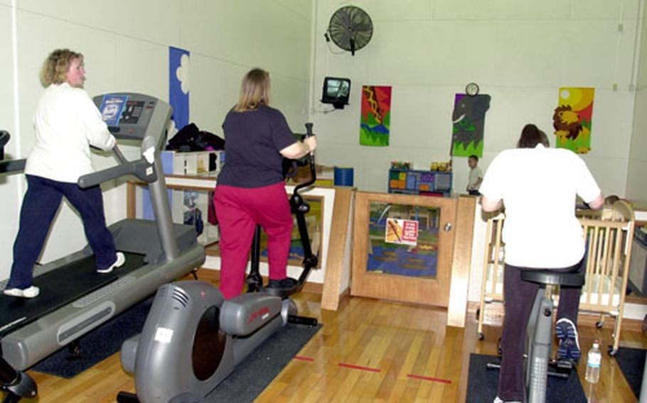 Misawa Air Base moms exercise in the parent-and-toddler room at Potter Fitness Center on Wednesday. The room is one of several that will close for several weeks starting Monday while lights are replaced.