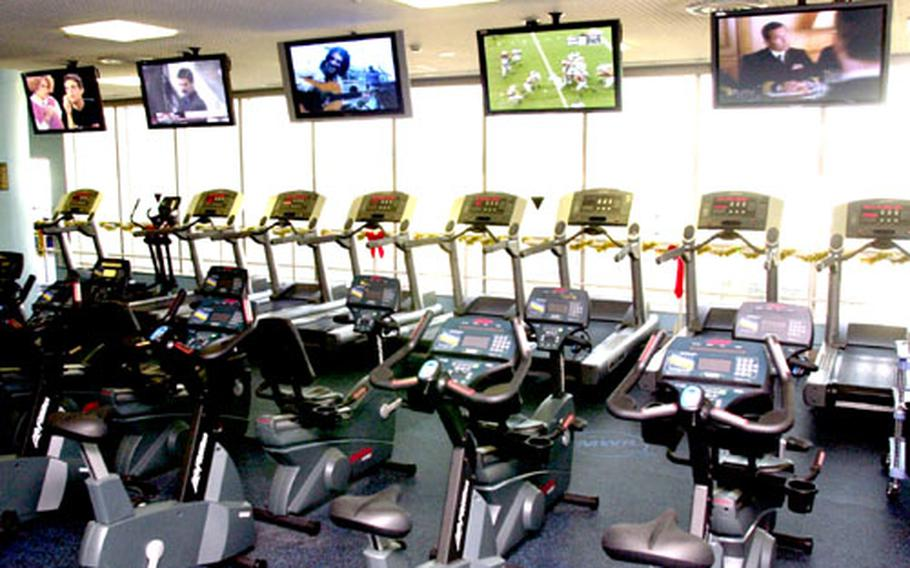 While working out at Yokosuka Naval Base, Japan, people now can enjoy a new cardio theater system that allows exercisers to plug in and watch any of five large-screen televisions.