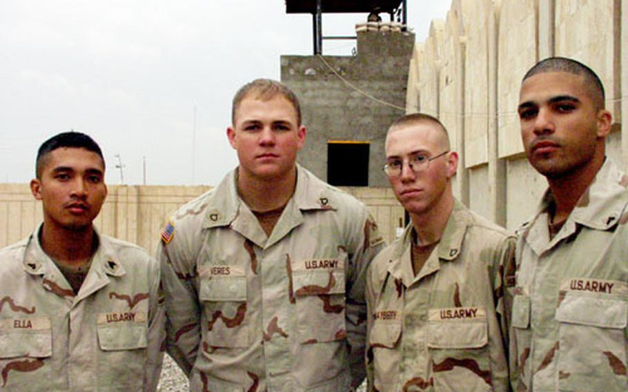 The soldiers of Battery A, 4th Battalion, 27th Field Artillery of the 1st Armored Division patrol one of the hottest areas of Baghdad. Ten of them have been awarded Purple Hearts. The unit's members include, from left, Sgt. Ross Ella, Pfc. Dusty Veres, Pfc. Jonathan Mayberry and Sgt. Eric Chargois. Mayberry has two after surviving attacks just days apart.