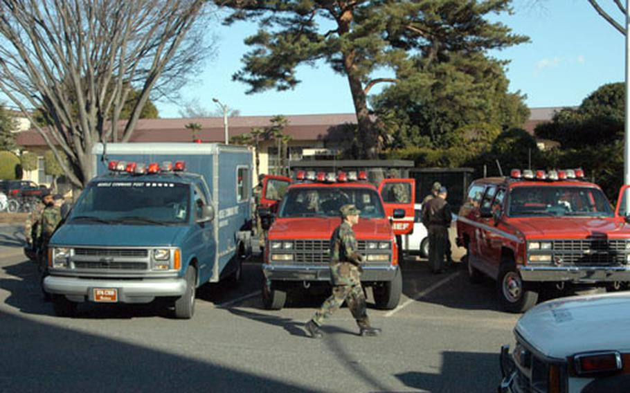 Yokota Air Base, Japan, emergency vehicles are parked in the lot of the West Chapel following a bomb threat Thursday. Security forces cordoned off several blocks around Yokota Community Center, which is near the parking lot where a threatening note was found.