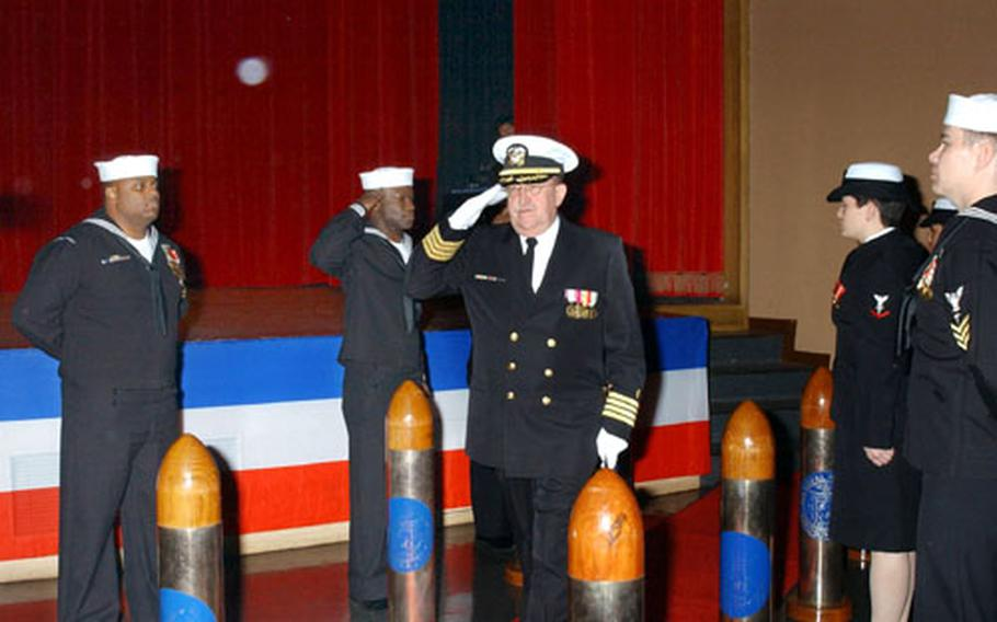 New Naval Hospital Yokosuka commander Capt. Charles Taylor salutes during a change of command ceremony Friday at Fleet Theater.