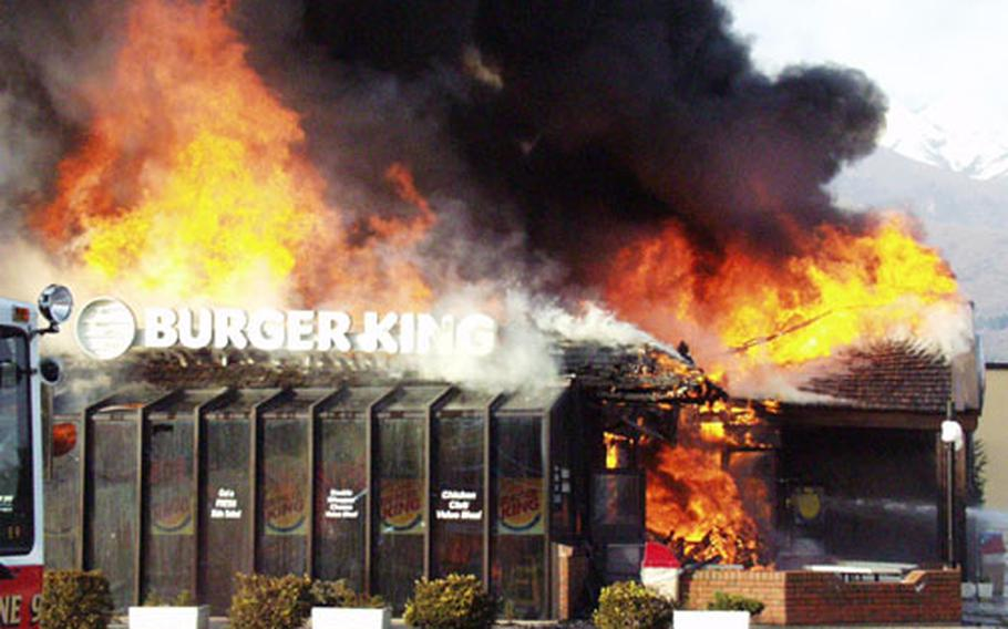 The Burger King building on Area 1 at Aviano Air Base went up in flames Monday afternoon. Much of the ceiling was already in flames by the time base firefighters arrived.