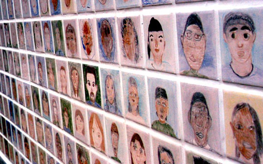 A wall outside the new John O. Arnn Elementary School at the Army's Sagamihara housing area in Tokyo holds the likenesses of more than 500 teachers and students.