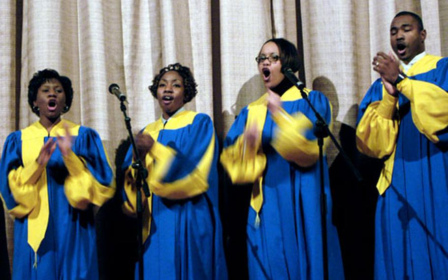 From left, Tanisha Norris, Janielle Thompson, Karnita Allen and Adell Jones sing a gospel number during the Mannheim, Germany, military community's celebration honoring Dr. Martin Luther King Jr. at the Schuh Theater on Wednesday.