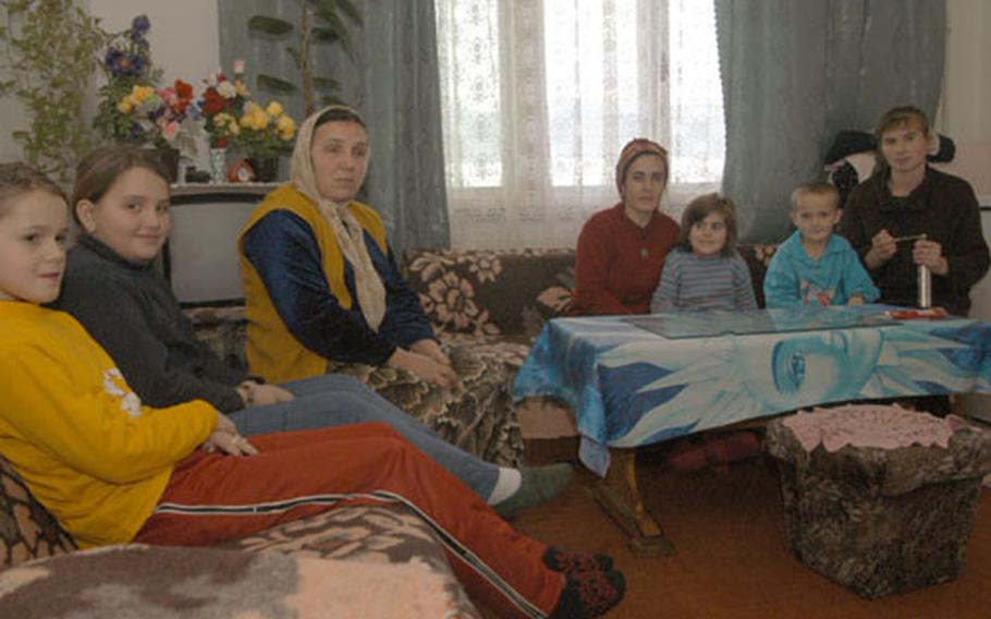 From left, Begajeta Ademovic, Refija Bajramovic and Galiba Muhic and their children have been living in a collective center with poor living conditions in a coal mining company building in Dolovi, Bosnia and Herzegovina, for more than two years. Local and international authorities have been running efforts to shut down all collective centers, and are faced with a challenge of finding a fitting alternative for the people living in them.