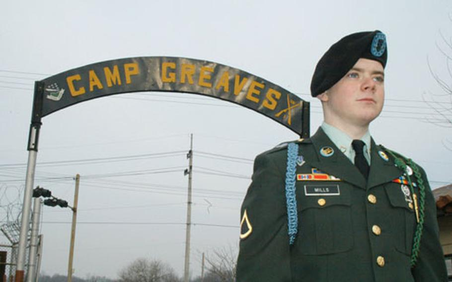 Private 1st Class Christopher Mills stands outside Camp Greaves on Friday.