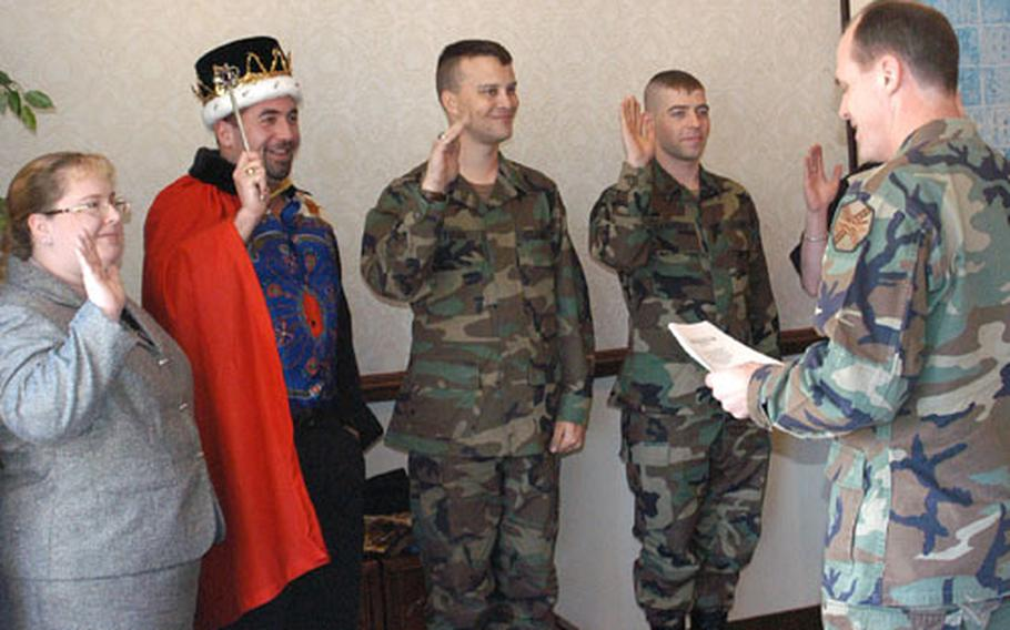 U.S. Army Garrison Japan Commander Col. Garland Williams, right, reads the oath the Army's new community mayors will swear to. From left, Rhonda Clopton (Segami Depot); John Gallagher (single civilians); Nathan Twigg (Sagamihara); and George Lawrence (single soldier), will serve for one year.