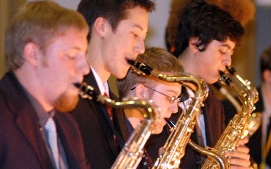 Members of the saxophone section of the DODDS Jazz Seminar 2004 big band blow their horns during a concert in Wiesbaden on Thursday.