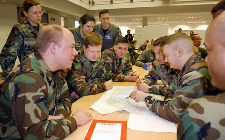 U.S. airmen plan for combat air operations Wednesday during the first phase of Austere Challenge 2004. The three-phase exercise is designed to certify U.S. Air Forces in Europe's ability to perform its mission as a warfighting headquarters.