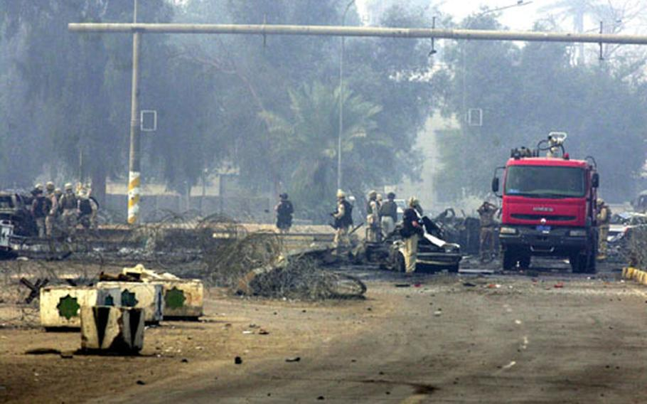 Investigators sift through the remains to determine the strength of the blast Sunday in Baghdad.