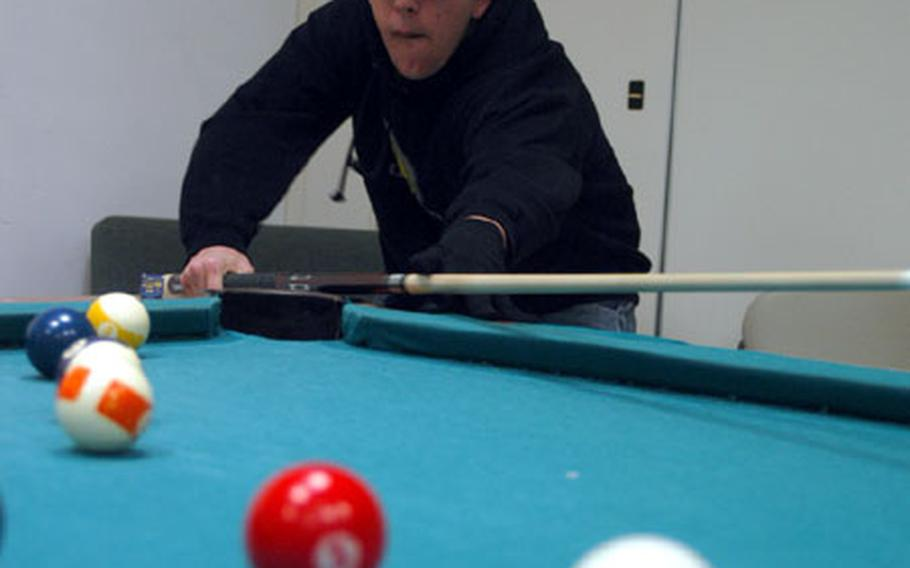 Richard Cody, 16, a junior at Naples American High School, shoots pool at the Teen Center at the Gricignano support site. Cody won a worldwide first-place award in music-making for the Boys and Girls Clubs of America Digital Arts Festival.