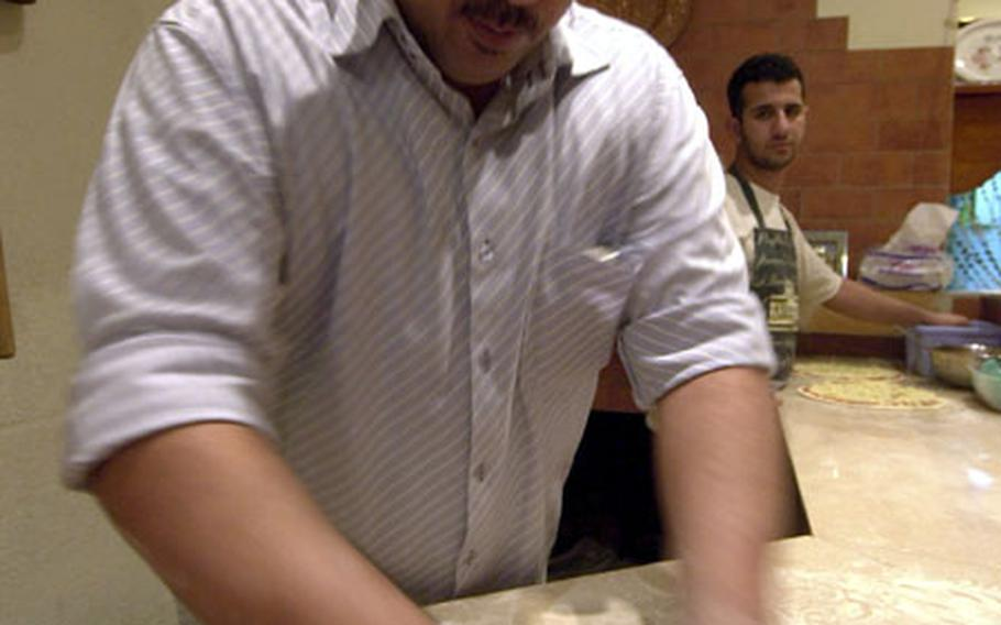 The night before the car bomb, Pizzeria Napoli owner, Waleed Al-Bayati makes the best pizzas in Iraq for the soldiers and hopes for more business in the future as the Iraq economy improves.