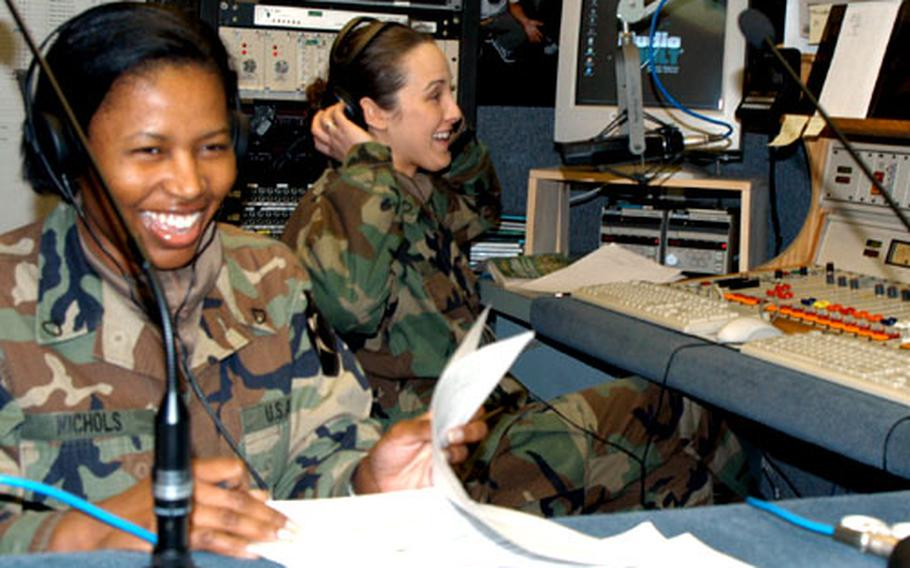 """Pfc. Katrina Nichols, left, and Pfc. Christina Mee host Warrior Radio's new show """"2ID Talk"""" from their studio at Camp Falling Water, South Korea."""