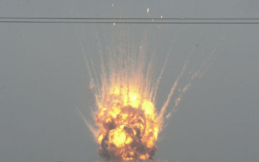 Seventy tons of Iraqi ordnance explode.