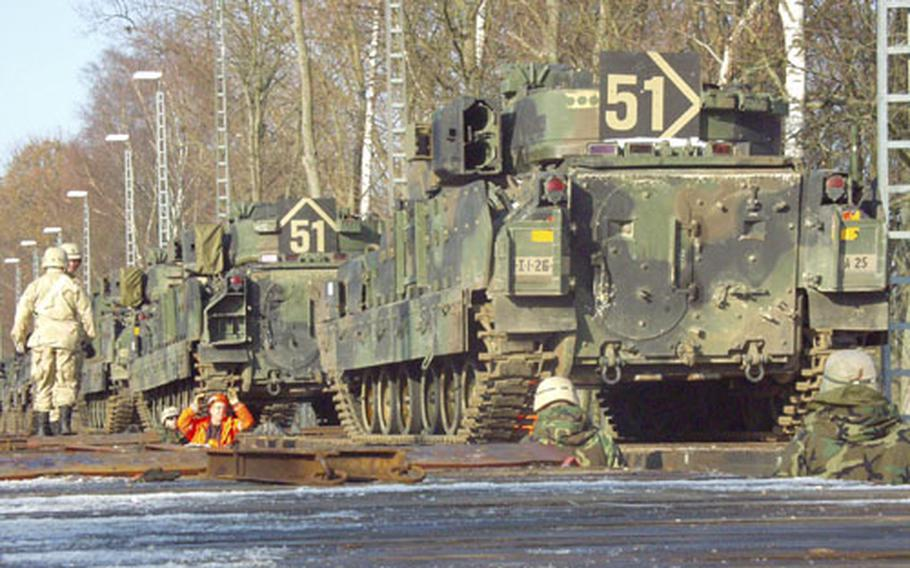 Lines of tracked vehicles fill railcars Friday at Conn Barracks in Schweinfurt, Germany, last week for shipment to Kuwait. The 1st Infantry Division's 1st Battalion, 26th Infantry, based in Schweinfurt, will join the 12,000-strong Big Red One next month in Iraq, part of one of the largest rotations of troops in history.