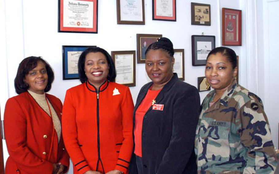 Local and stateside members of the Delta Sigma Theta sorority - the largest African-American women's sorority in the world - meet at Camp Zama this month. From left are Dr. Vanita Nicholas; Dr. Thelma James Day, far west regional director; Bonnie Cheatham, Tokyo Alumnae Chapter president; and Maj. Jacqueline Lett, Camp Zama.