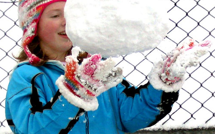 Victoria Carpenter, 11, created a snowball to counteract anything in her friends' arsenal during last week's snowy weather at Sasebo.