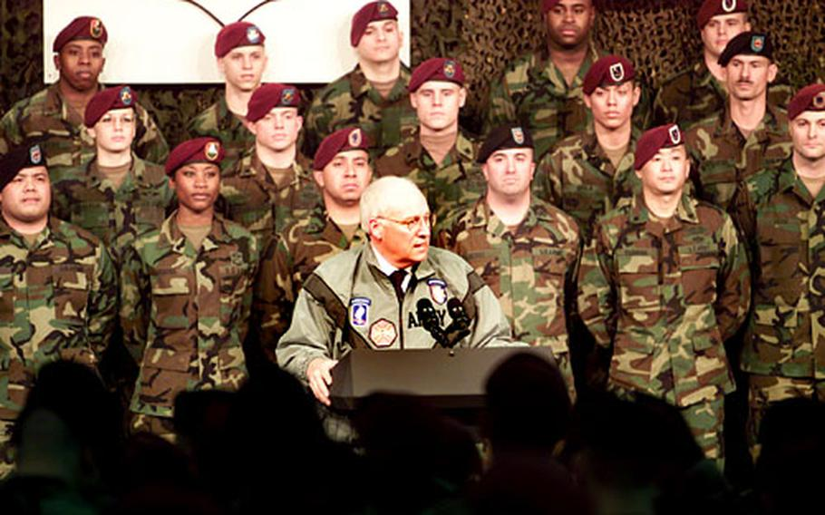 Vice President Dick Cheney speaks at Caserma Ederle, Italy, Tuesday. Cheney reenlisted four soldiers and presented two Purple Hearts to servicemembers wounded in Iraq.