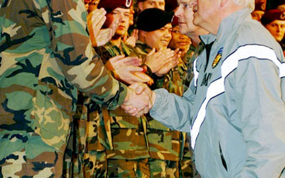 Vice President Dick Cheney greets a Southern European Task Force (Airborne) soldier during his trip to Caserma Ederle.