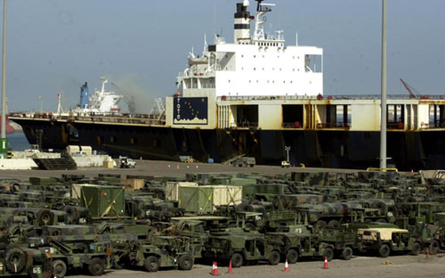 Hundreds of military vehicles are lined up at Shu'Aibah Port, Kuwait, after being unloaded from cargo ships.