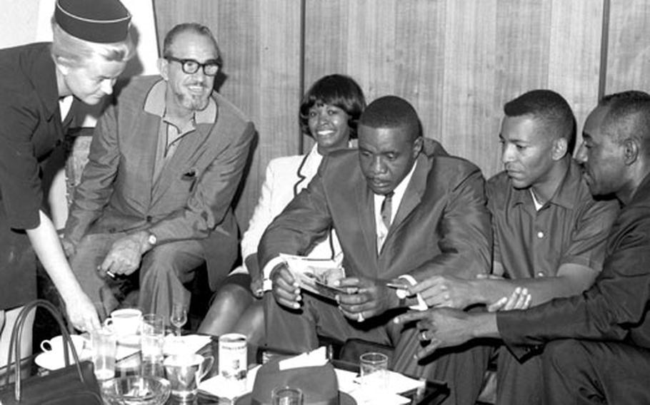 Sonny Liston and his entourage prepare for the trip home.