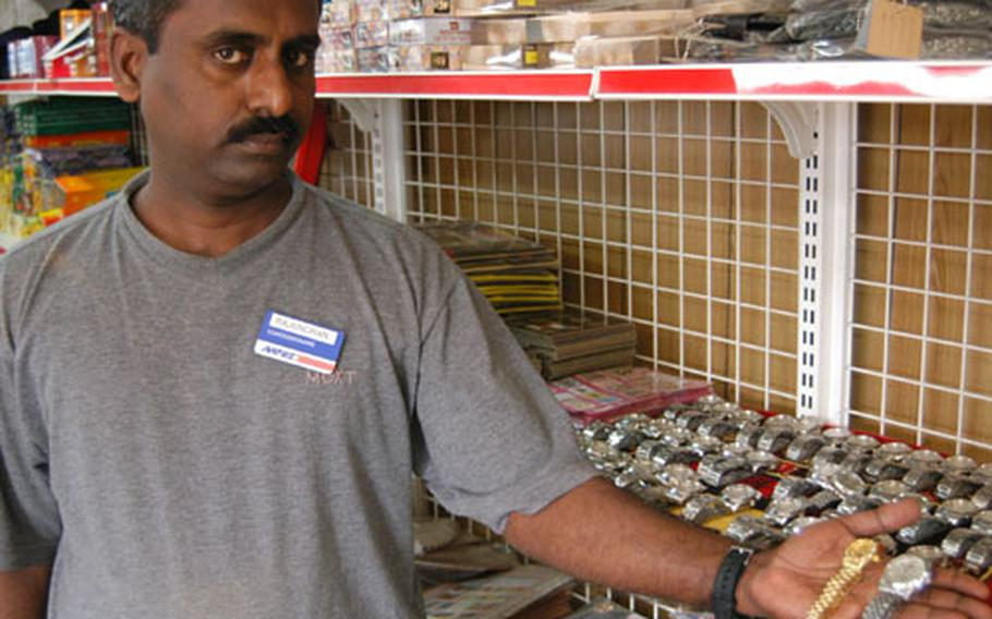 An AAFES concessionaire displays counterfeit watches and sunglasses on sale at Baghdad International Airport in Iraq.