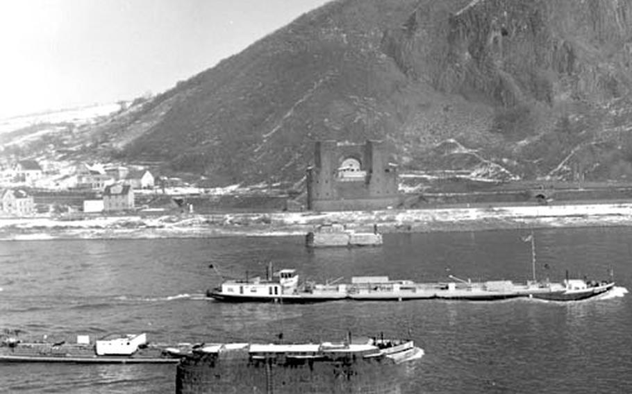 Ships on the Rhine pass the ruins of the bridge at Remagen.