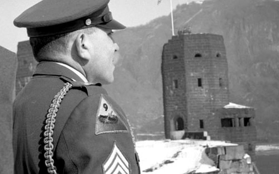 Sfc. Joseph A. De Lisio in front of the Ludendorff Bridge in 1962.