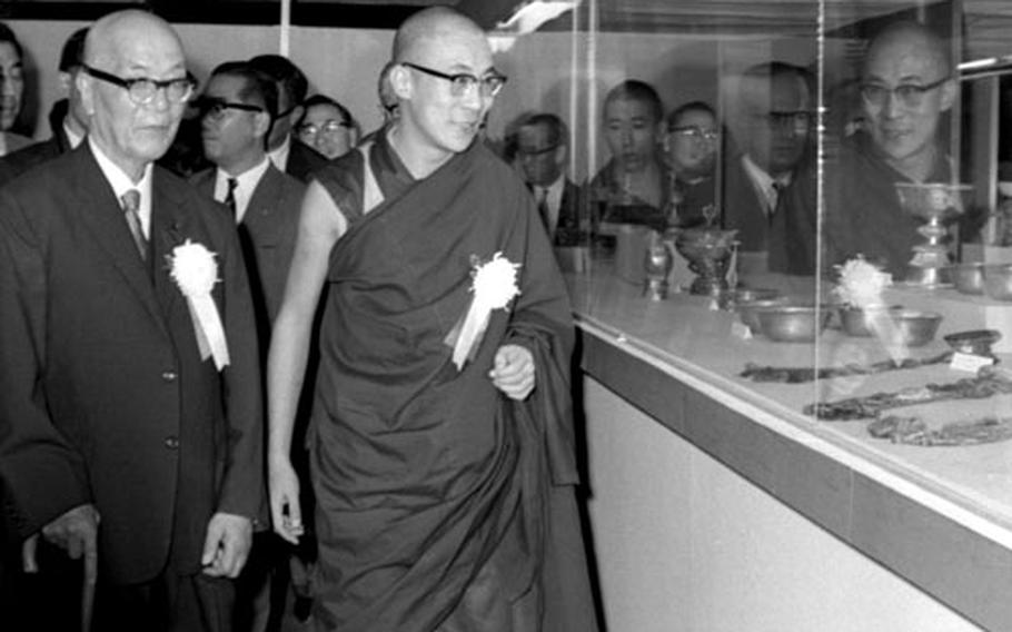 The Dalai Lama and Japanese media magnate Matsutaro Shoriki tour the Tibetan art exhibit at Ueno after the ribbon-cutting ceremony in September, 1967.